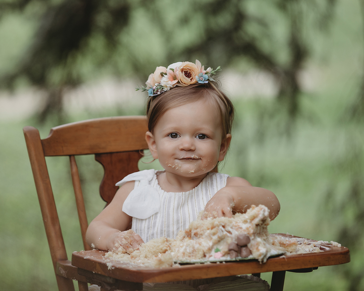 Vintage outdoor cake smash with one-year-old baby