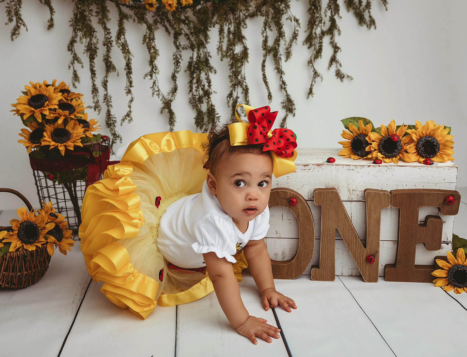 Toddler in yellow tutu and red headband with sunflower set