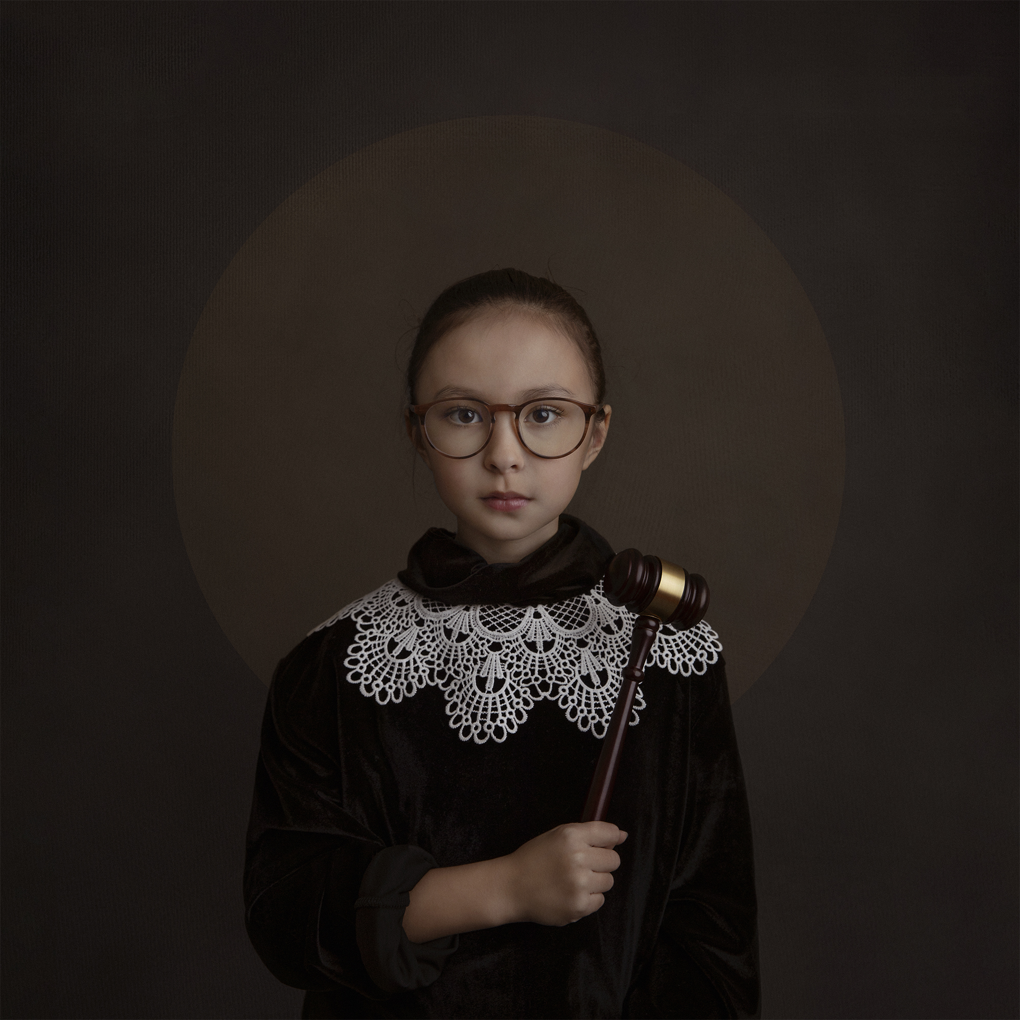 Young girl dressed as Ruth Bader Ginsburg