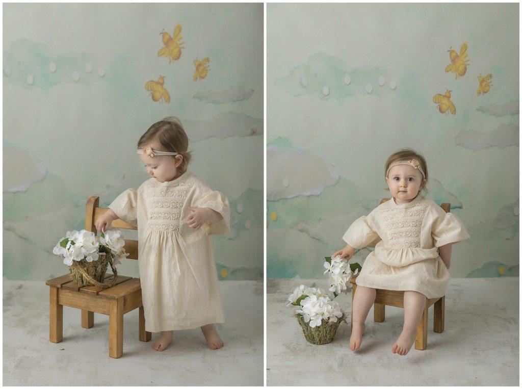 Portrait of toddler girl in boho dress on with hydrangeas.