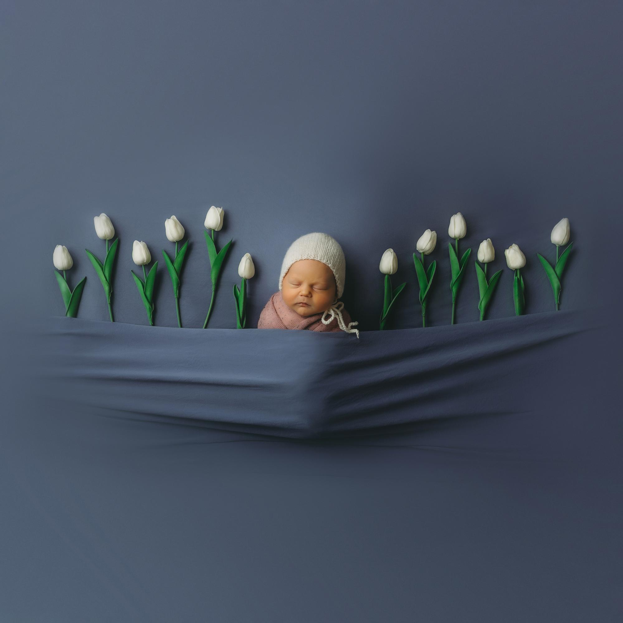 Newborn portrait with tulips